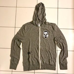 Thin grey zip-up hoodie with funky logo